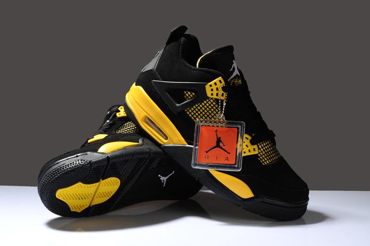 black and yellow jordan 4